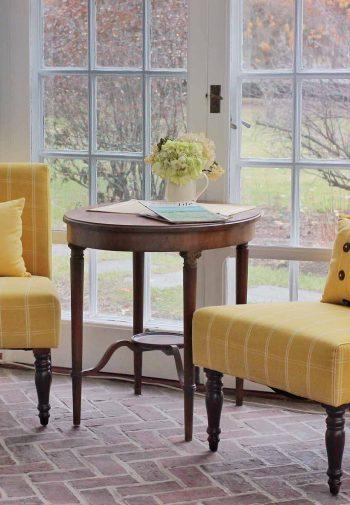 sun room yellow chairs four chimneys inn patio
