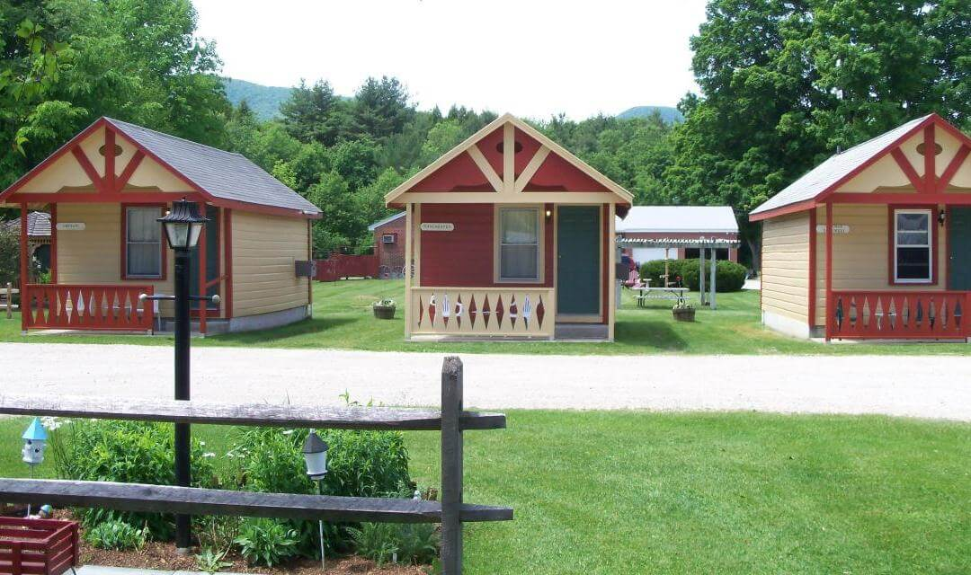 colorful cabins in a row on a lawn