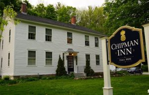 white colonial home with Chipman Inn sign