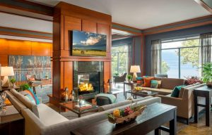large sitting area with fireplace and TV and view of lake champlain