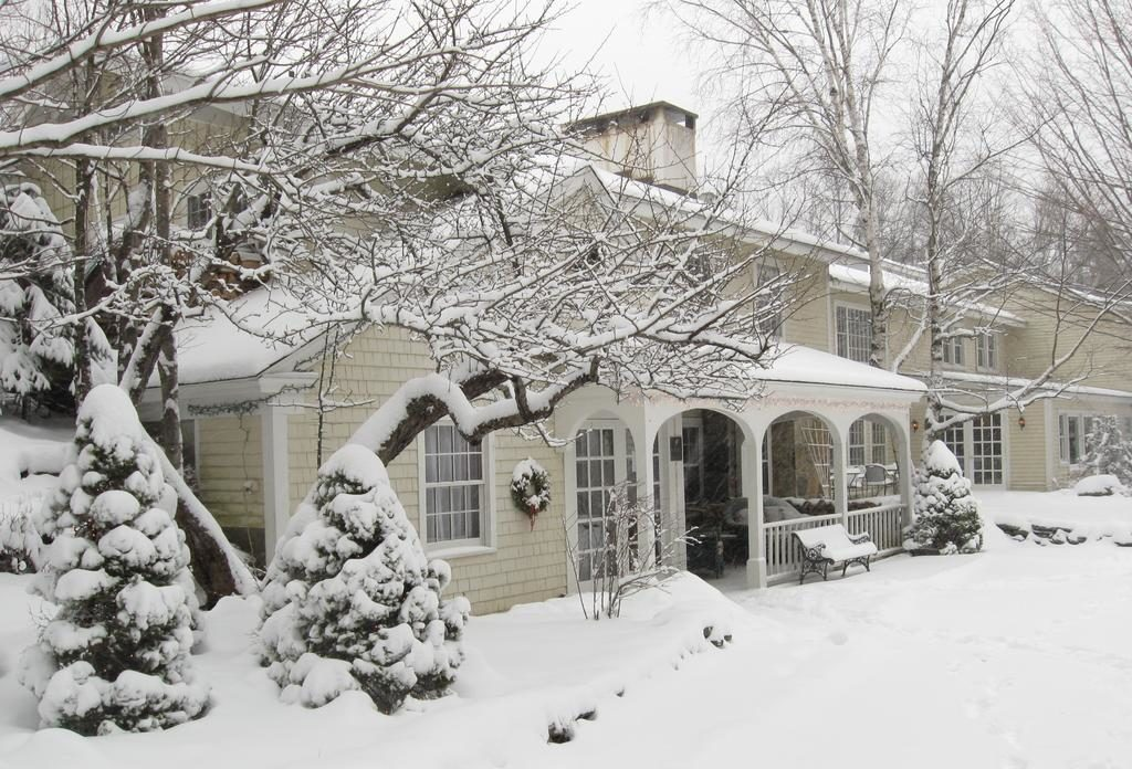 snow oovered beige building with arches at the entry