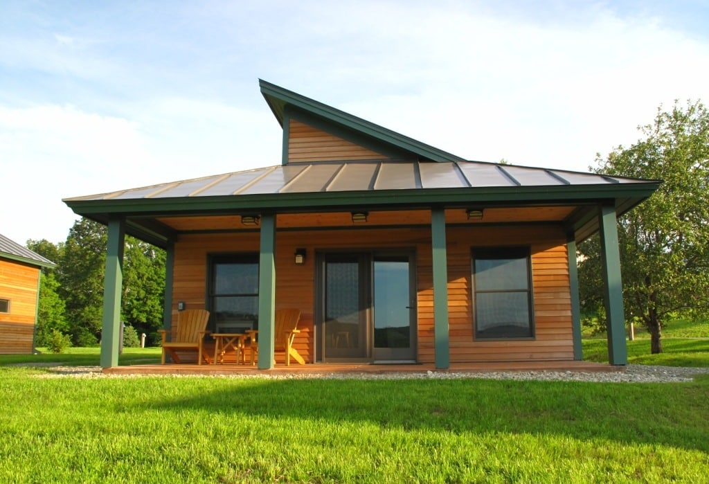 contemporary cabins with wood siding and green columns