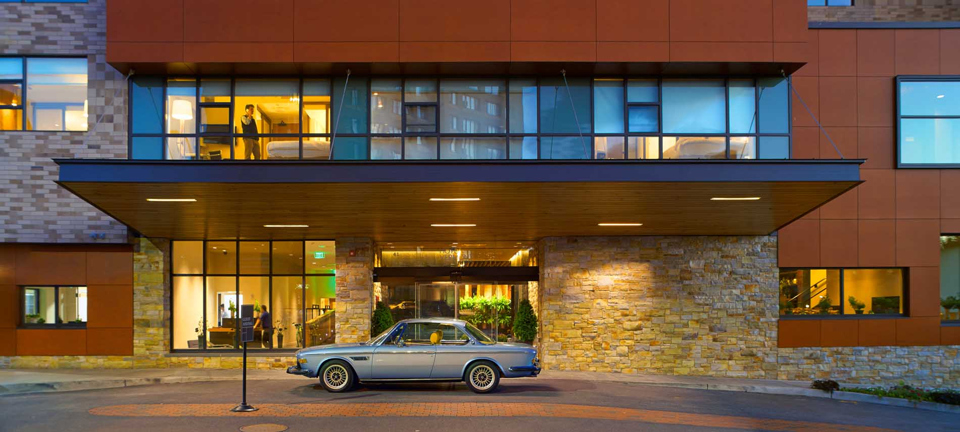 hotel vermont at dusk car parked at entrance