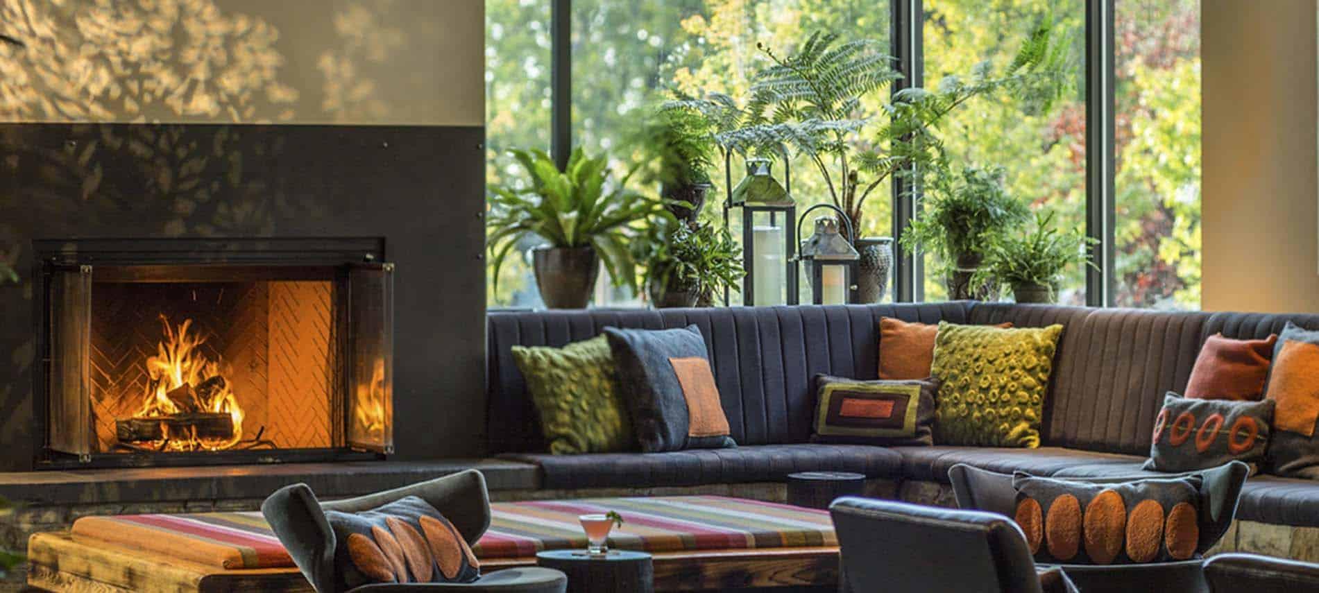 hotel vermont lobby modern throw pillows burning fireplace