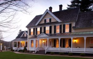 illuminated beige building with white porch rails