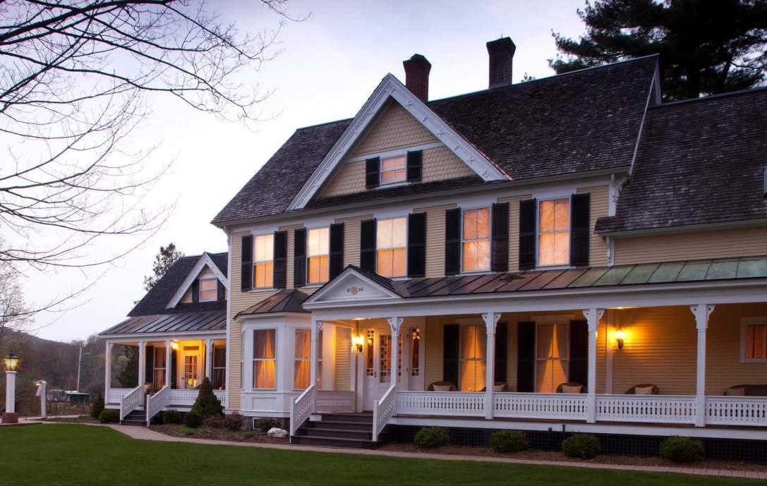 illuminated beige building with white porch rails