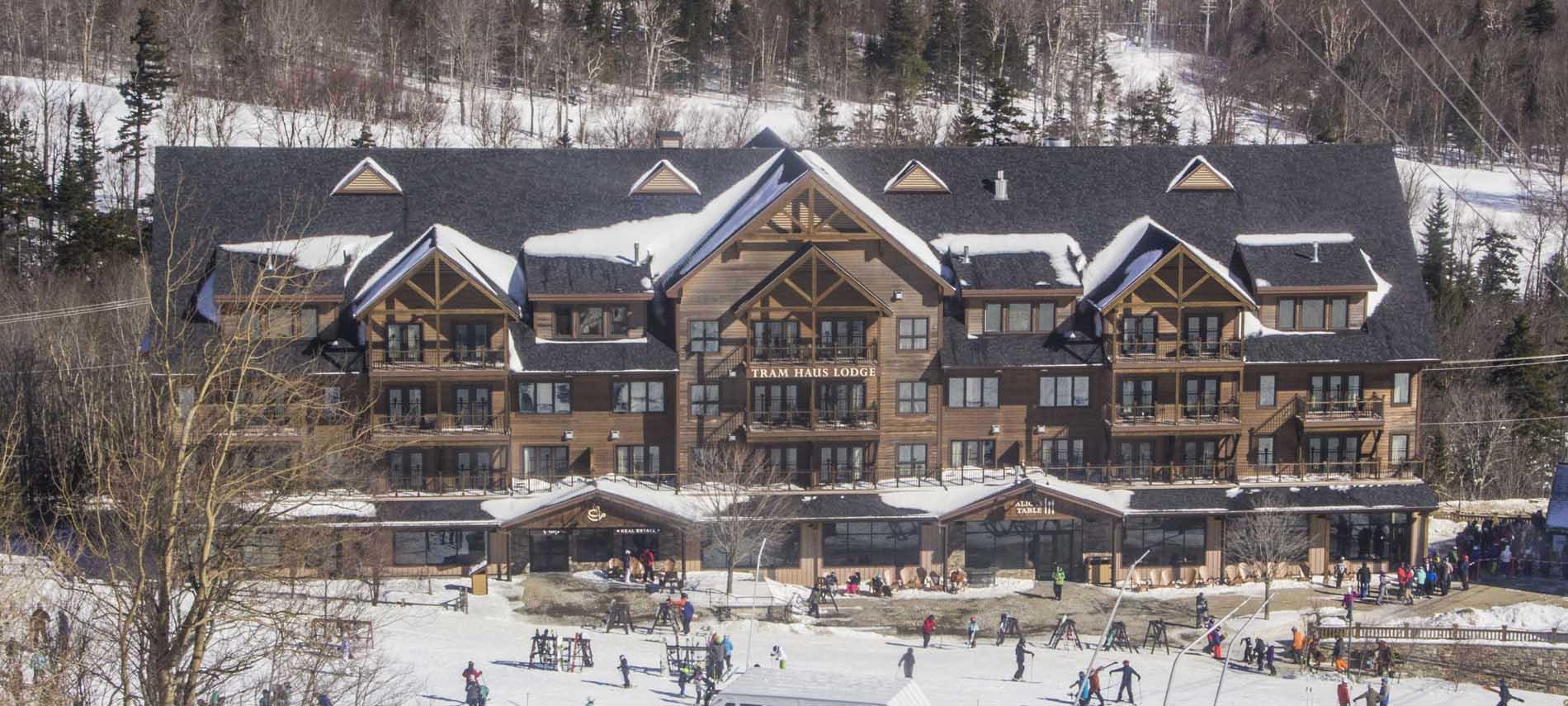 jay peak vermont ski resort base lodge busy with skiers