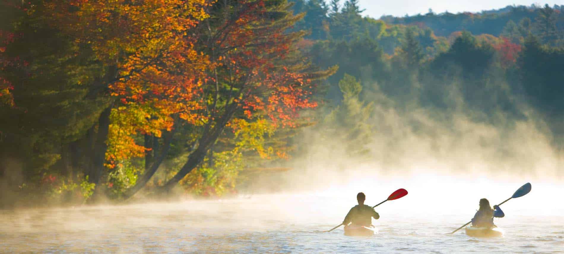 2 kayaks on misty vermont mountain lake