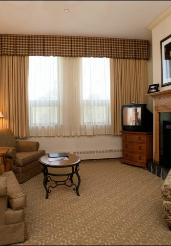 One-bedroom hotel suite with large sitting area.