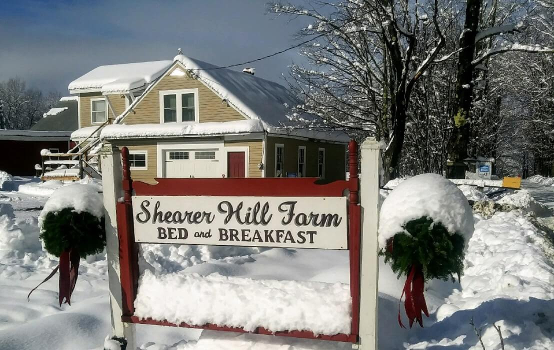 beige house behind Shearer Hill Farm signage