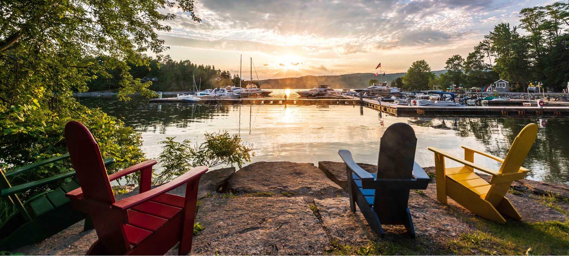 lake view at basin harbor adirondack chairs sunset